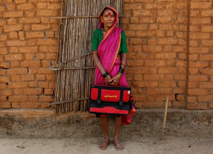 Drupada Pandurangkedar, 70, who studies at Aajibaichi Shaala (Grandmothers' School), poses for a photograph outside her house in Fangane village, India, February 15, 2017. Credit: Danish Siddiqui/Reuters