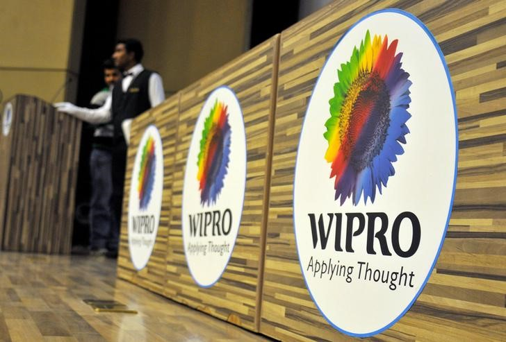 Stewards are seen behind desks with the logo of India's third-largest software services firm Wipro Ltd inside the company's headquarters in Bengaluru, India, October 21, 2016. Credit: Abhishek N. Chinnappa/Reuters