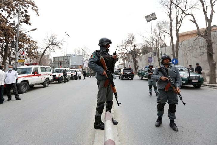 Afghan policeman stand guard at the site of a blast and gunfire in Kabul, Afghanistan March 8, 2017.REUTERS/Mohammad Ismail