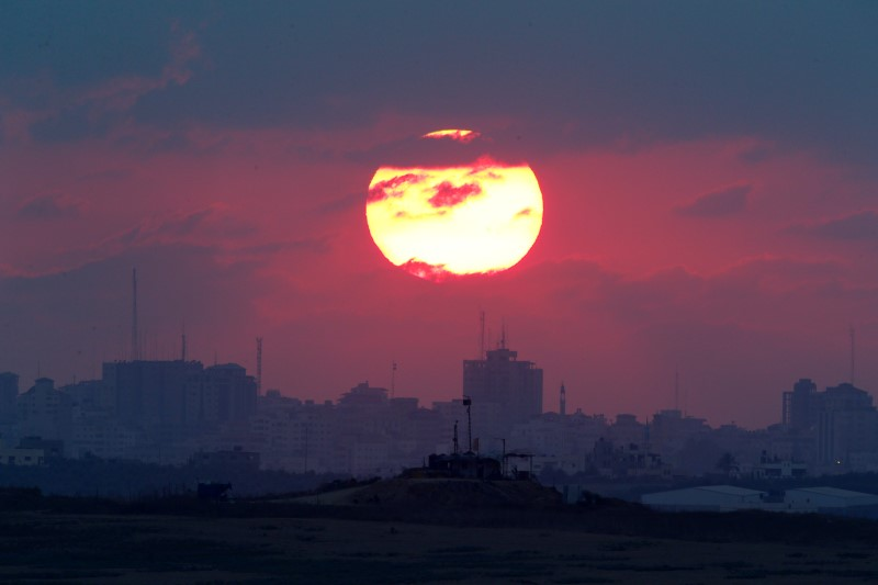 The sun sets over the Gaza Strip, as seen from the Israeli side, September 2016.    Credit: Amir Cohen/Reuters/Files