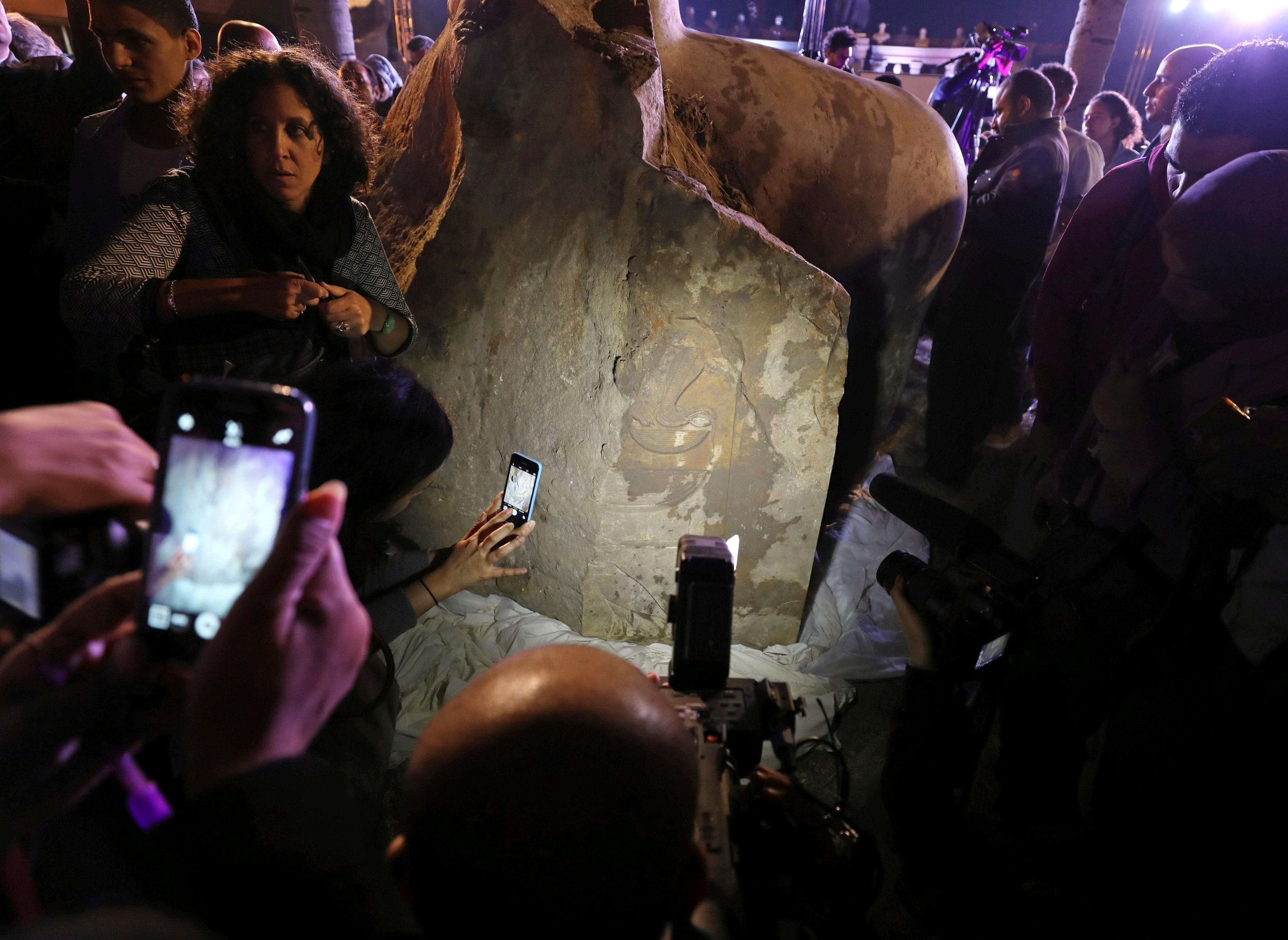 Crowd of onlookers observes a recently disocvered colosus now believed to be of Psammetich I in Cairo, Egypt, March 16, 2017. Credit: Mohamed Abd El Ghany/Reuters