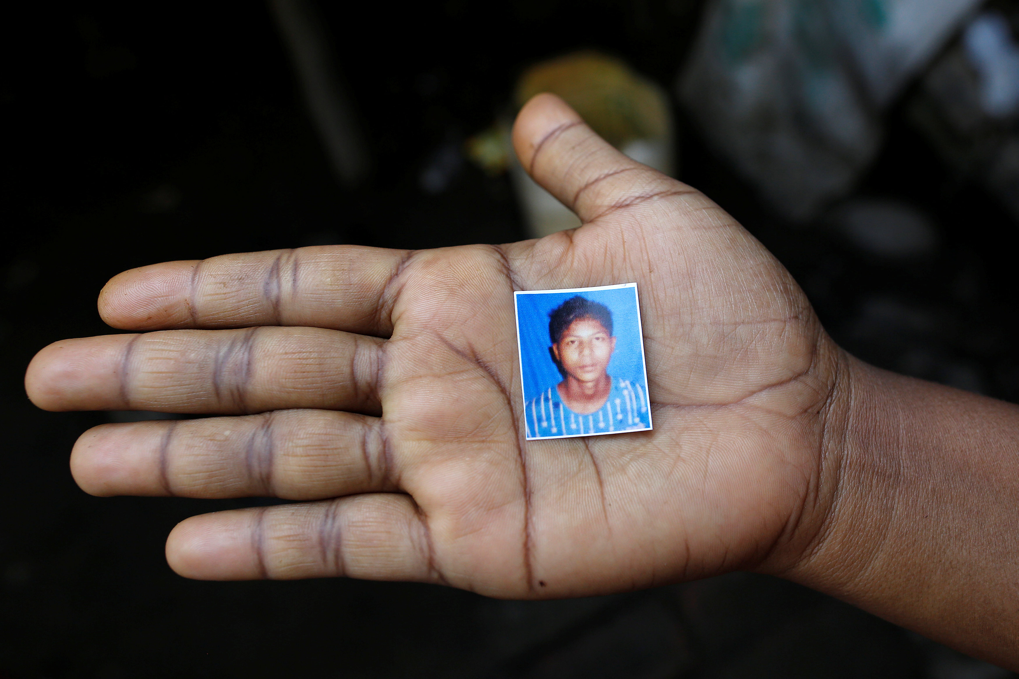 A relative holds a picture of detained Rohingya fisherman Mohammed Enus, 18, in Sittwe in the state of Rakhine, Myanmar March 2, 2017. Credit: Reuters/Soe Zeya Tun