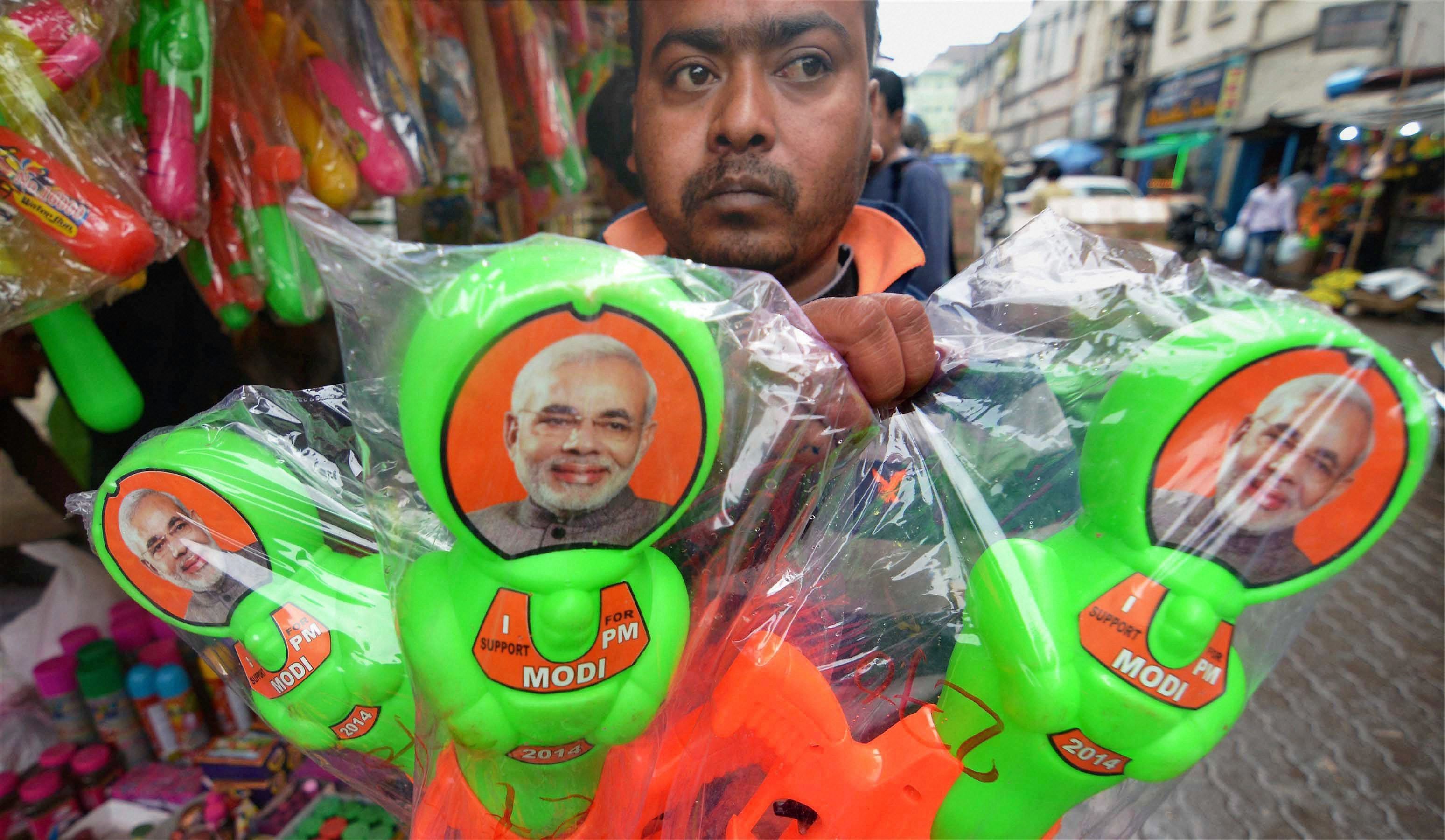 A vendor sells water-guns with photographs of Prime Minister Narendra Modi ahead of Holi' in Guwahati on Saturday. Credit: PTI