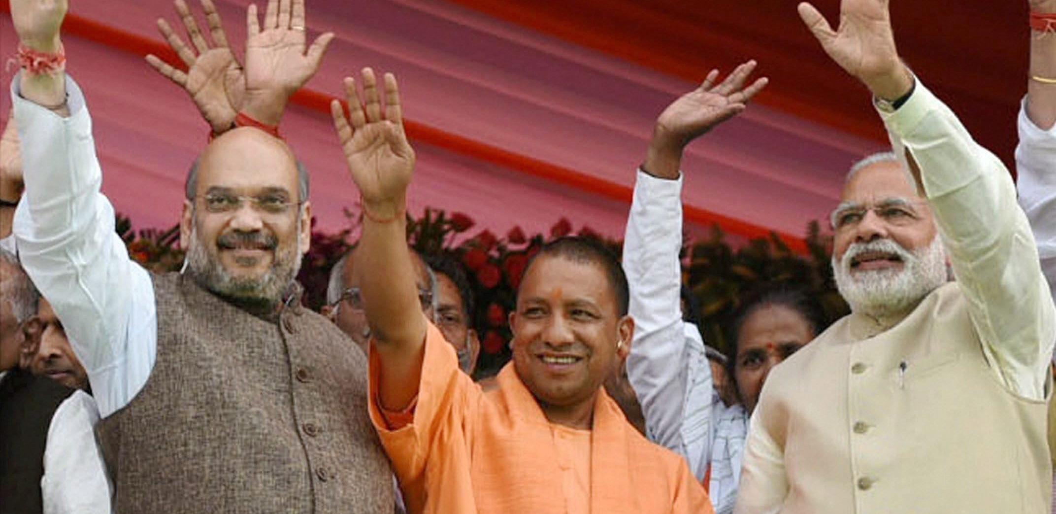 Lucknow: Prime Minister Narendra Modi and BJP President Amit Shah with the new Chief Minister Yogi Adityanath at the swearing-in ceremony of the new government of Uttar Pradesh, in Lucknow on Sunday, March 19. Credit: PTI