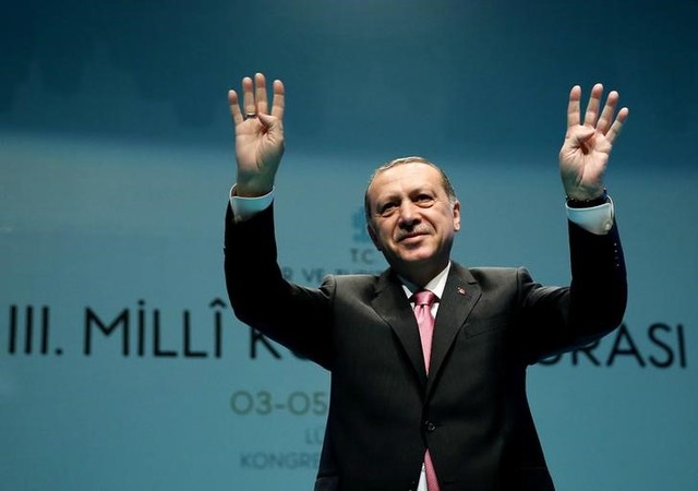 Turkish President Tayyip Erdogan greets the audience during a conference in Istanbul, Turkey, March 3, 2017. Credit: Yasin Bulbul/Reuters
