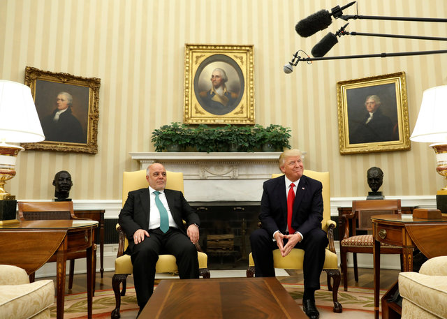 US President Donald Trump meets with Iraqi Prime Minister Haider al-Abadi in the Oval Office at the White House in Washington, US, March 20, 2017. Credit: Reuters/Kevin Lamarque
