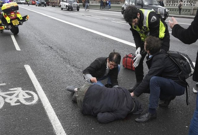 An injured person is assisted after an incident on Westminster Bridge in London, Britain March 22, 2017.  Credit: Reuters/Toby Melville