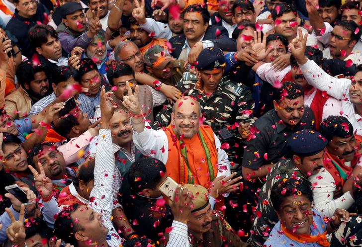 Amit Shah (C), president of India's ruling Bharatiya Janata Party (BJP) gestures as he celebrates with party supporters after learning of the initial poll results inside the party headquarters in New Delhi, India, March 11, 2017. Credit:Adnan Abidi/Reuters