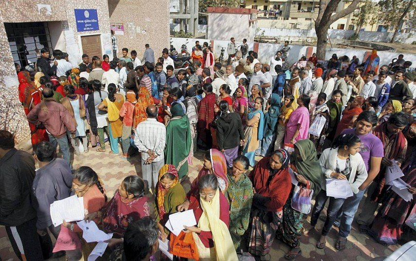 People standing in queues to collect forms of Aadhar Card at a centre in Ahmedabad. Credit: PTI/Files