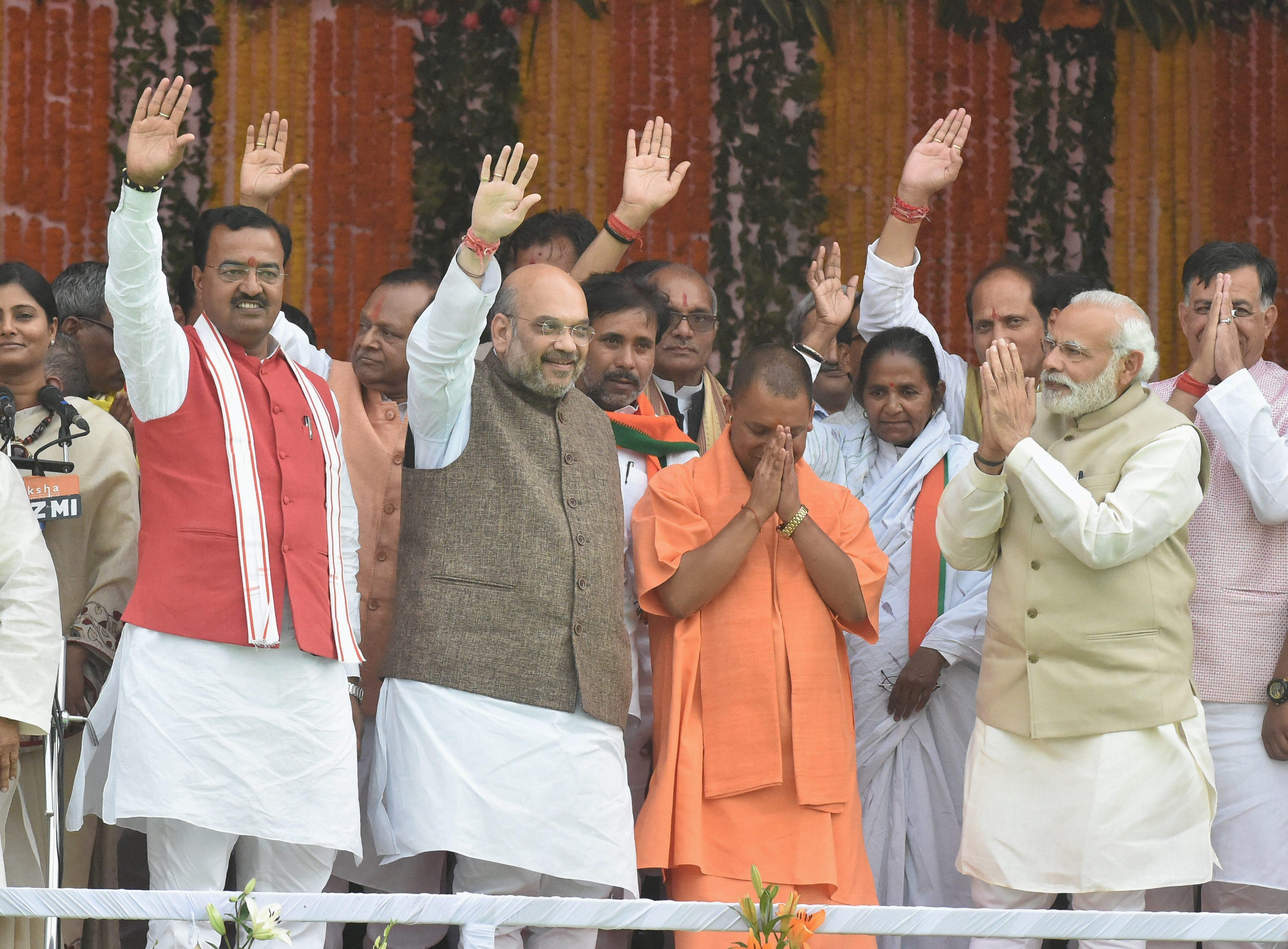 Prime Minister Narendra Modi, BJP president Amit Shah, the newly sworn-in chief minister of Uttar Pradesh Yogi Adityanath and ministers after the oath ceremony in Lucknow on Sunday. Credit: PTI/Nand Kumar