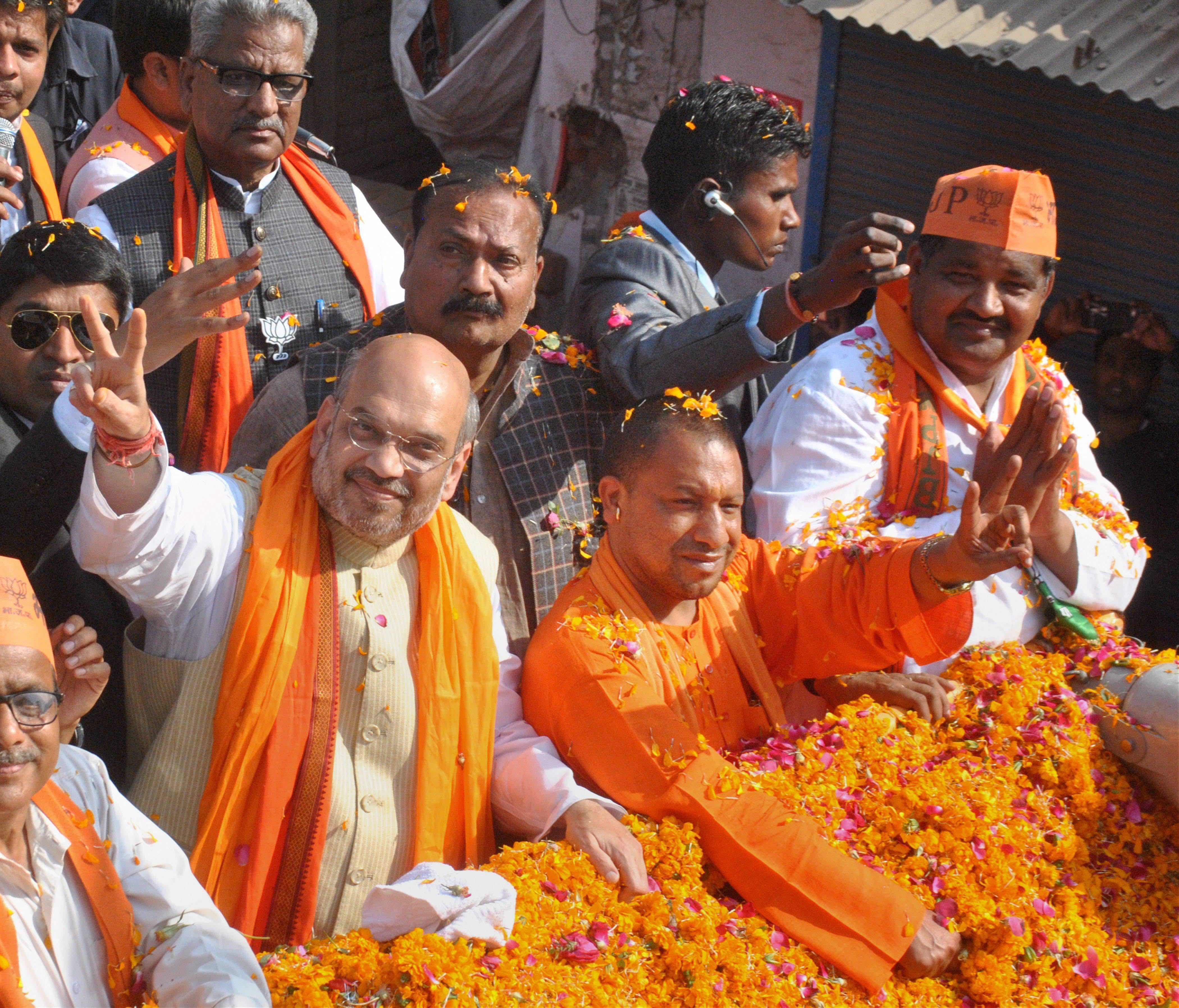 BJP president Amit Shah with party MP Yogi Aditya Nath during an election road show in Gorakhpur district on Thursday. Credit: PTI