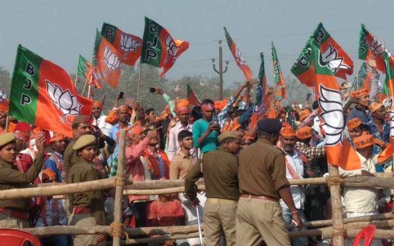 BJP supporters cheer during Prime Minister Narendra Modi's rally in Deoria. Credit: Titash Sen