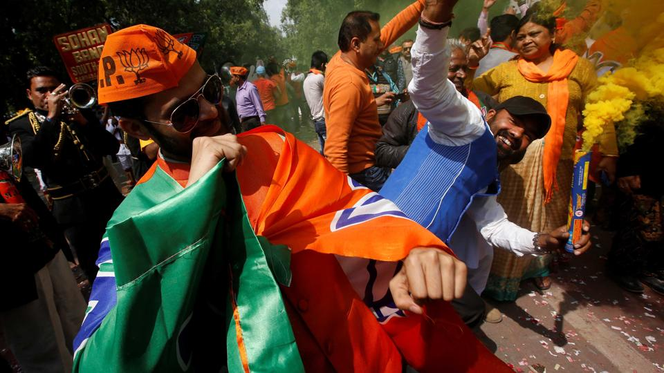 BJP workers celebrate outside the party headquarters in New Delhi, March 11, 2017. Credit: Reuters