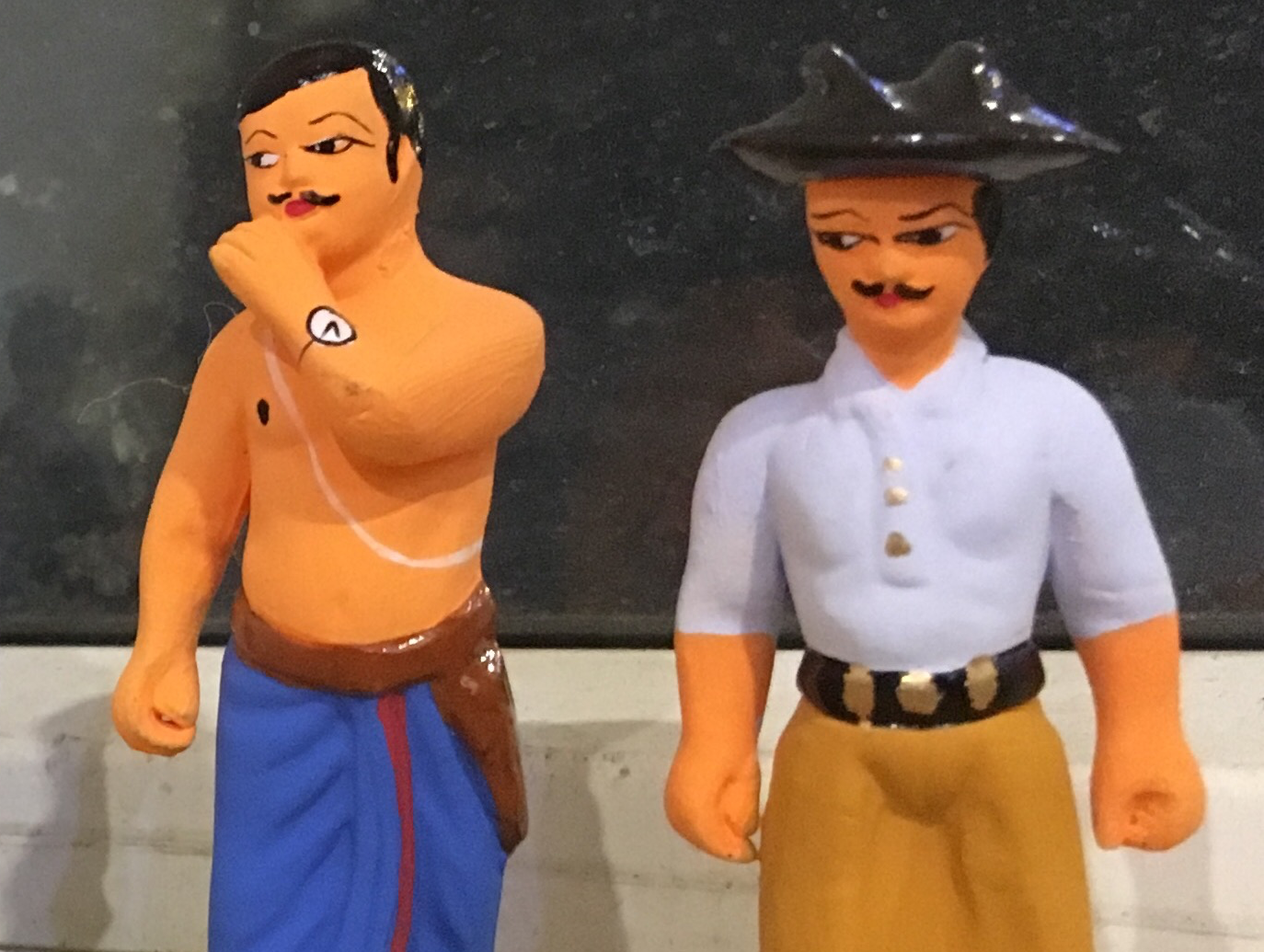 Miniatures of Chandrashekhar Azad (left) and Bhagat Singh. Credit: The Wire
