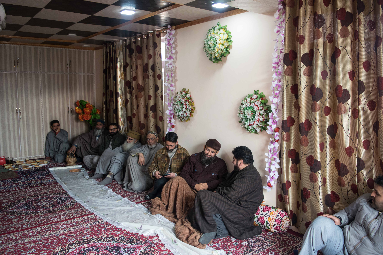 Tariq Ahmed Dar seen with visitors and family. Credit: Ruman Hamdani
