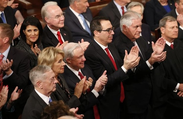 US President Donald Trump addresses joint session of Congress – Washington, US 28/02/17. Cabinet members applaud as US President Donald Trump addresses the US Congress. Credit: Reuters