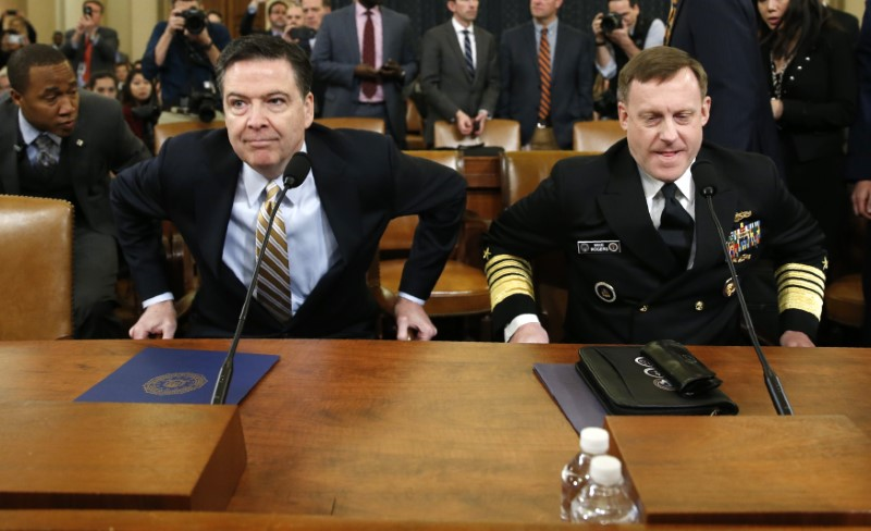 FBI director James Comey (L) and National Security Agency Director Mike Rogers take their seats at a House Intelligence Committee hearing into alleged Russian meddling in the 2016 US election, on Capitol Hill in Washington, US, March 20, 2017. Credit: Reuters/Joshua Roberts