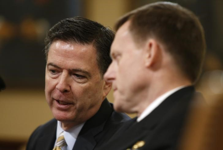 FBI director James Comey (L) and National Security Agency director Mike Rogers confer as they testify before the House Intelligence Committee hearing into alleged Russian meddling in the 2016 US election on Capitol Hill in Washington, US, March 17, 2017. Credit: Reuters/Joshua Roberts