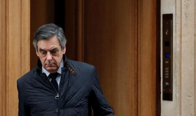 Francois Fillon, former French prime minister, member of The Republicans political party and 2017 presidential candidate of the French centre-right, leaves home in Paris, France, February 1, 2017. Credit: Reuters