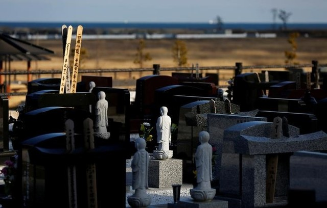 Stone statues of Jizo and gravestones are seen near a seaside devastated by the March 11, 2011 tsunami in Namie town near Tokyo Electric Power Co's (TEPCO) tsunami–crippled Fukushima Daiichi nuclear power plant, Fukushima prefecture, Japan, February 28, 2017. Credit: Reuters