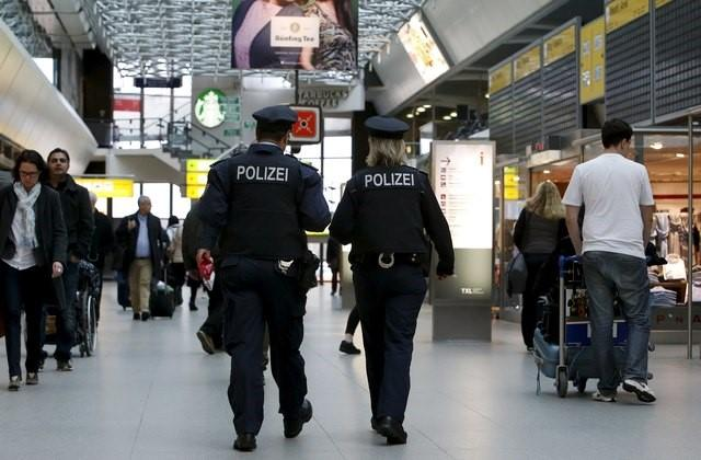 German federal police officers patrol inside the main hall connecting terminal A and B to provide security at Tegel airport in Berlin, Germany, March 23, 2016. Credit: Reuters