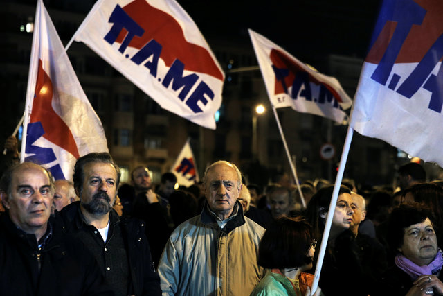 Members of the communist-affiliated PAME trade union take part in a demonstration outside a hotel, where members of the Greek government meet with representatives of the country's international lenders, in Athens, Greece March 1, 2017. Credit: Reuters