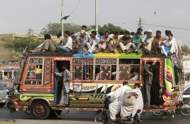 People travel on a bus in Pakistan's business city of Karachi, September 17, 2008. Credit: Reuters