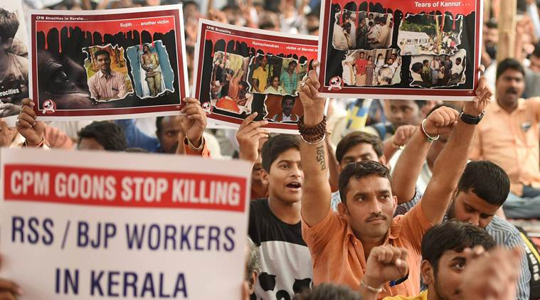 Members from the 'FACT' (The forum against communist terror) protest against attacks on RSS/BJP followers in Kerala in Mumbai. Credit: PTI
