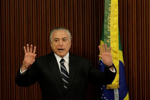 Brazil's President Michel Temer gestures during a meeting with the Pension Reform Commission at the Planalto Palace in Brasilia, Brazil, February 21, 2017. Credit: Reuters