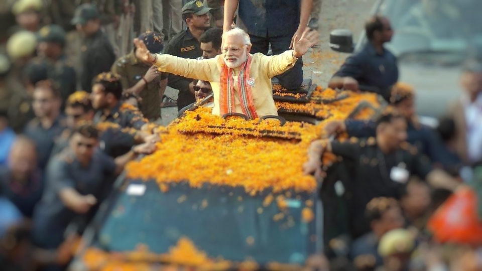 Prime Minister Modi at his roadshow in Varanasi. Credit: PTI