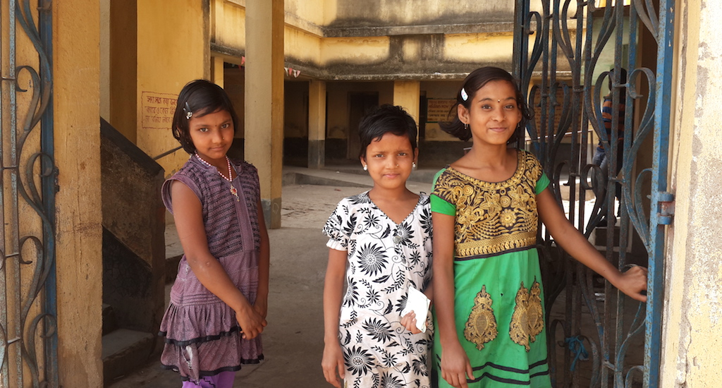 The confident children of Bamuha village in Murshidabad district welcome visitors to their school. Credit: Chhandosree