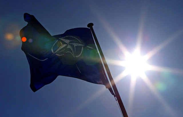 A NATO flag flies at the Alliance's headquarters in Brussels, March 2, 2014. Credit: Reuters