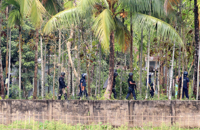 Security personnel get ready to raid a militant den in Nasirpur village, Moulvibazar, northeast of the capital Dhaka, Bangladesh, March 30, 2017. Credit: Reuters