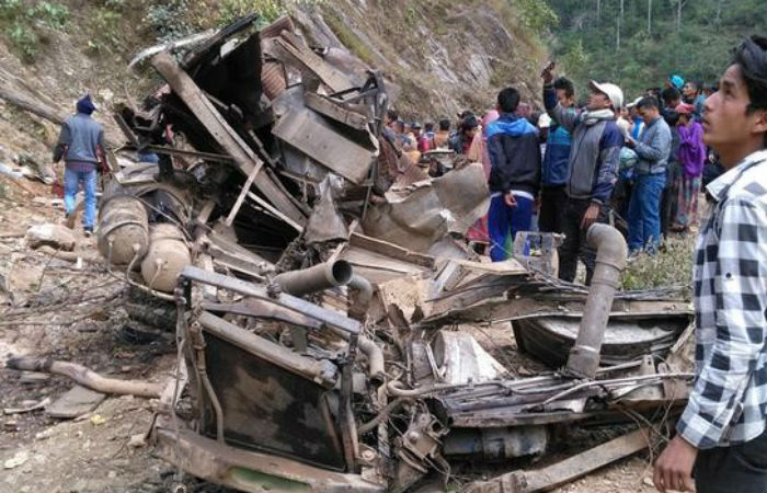 People gather along the wreckage of a bus after it veered off a hilly road in Jajarkot, Nepal March 9, 2017. Picture taken on March 9, 2017. Credit: Reuters/Files