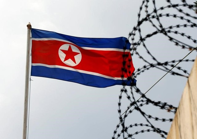 The North Korea flag flutters next to concertina wire at the North Korean embassy in Kuala Lumpur, Malaysia March 9, 2017. Credit: Reuters