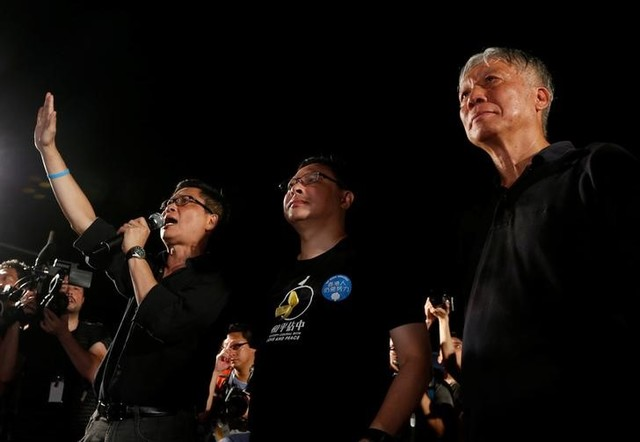 Founders of the Occupy Central civil disobedience movement (L-R), academic Chan Kin-man, academic Benny Tai and reverend Chu Yiu-ming attend a campaign to kick off the movement in Hong Kong, China August 31, 2014. Credit: Reuters