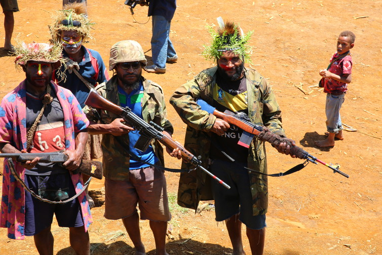 Armed clansmen in the town of Komo in Papua New Guinea's Hela Province. Credit: Michael Main/The Conversation