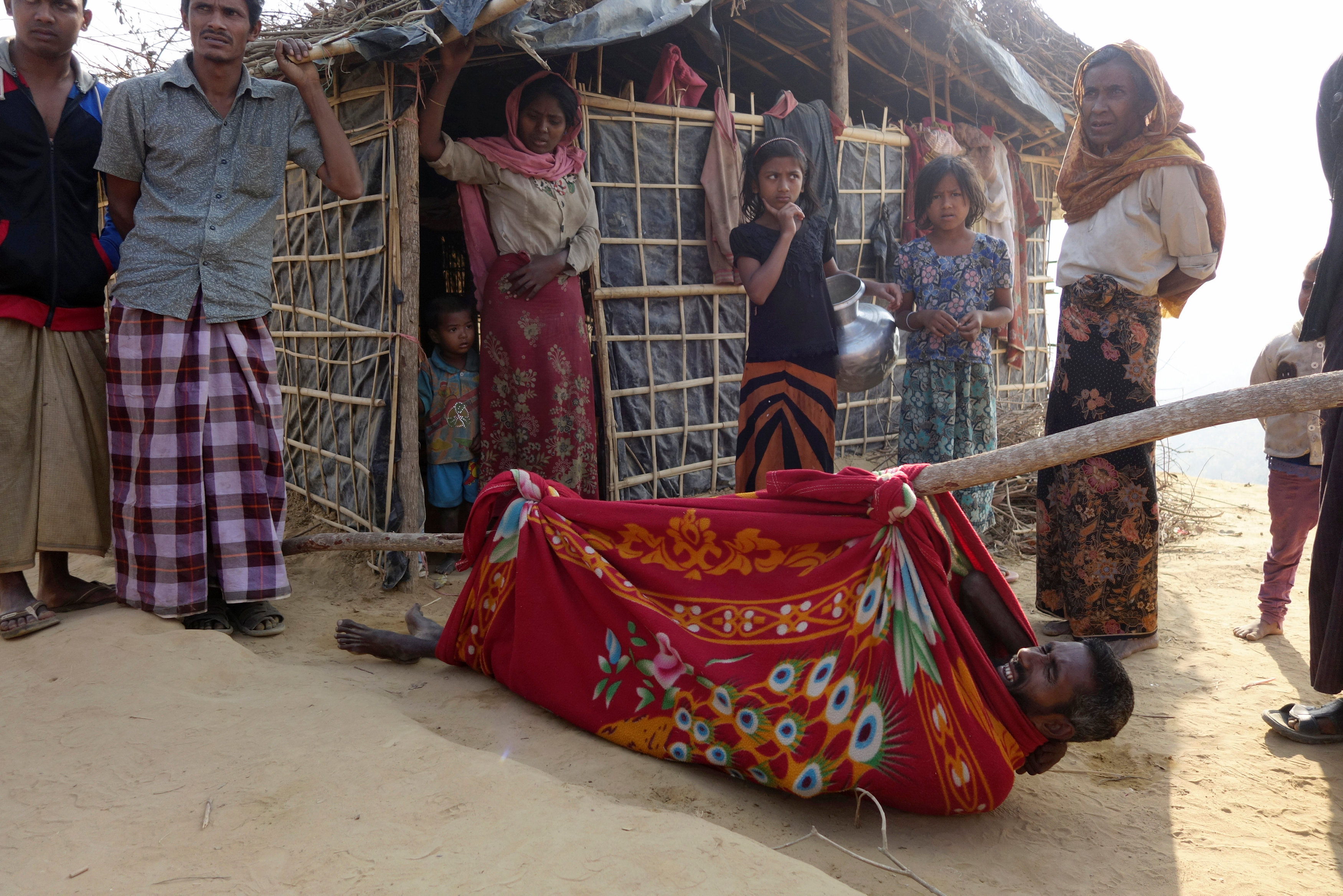 A Rohingya refugee disabled man waits in a makeshift stretcher after he was taken by relatives to visit a doctor at Kutupalang unregistered Refugee Camp in Cox's Bazar, Bangladesh, March 2, 2017. Credit: Reuters/Claudia Jardim