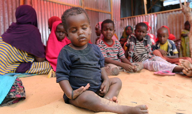 Internally displaced Somali children sit inside their general shelter at the Al-cadaala camp in Mogadishu. Credit: Reuters