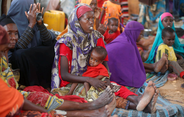 Internally displaced Somali women sit with their children inside their general shelter at the Al-cadaala camp in Somalia's capital Mogadishu, March 8, 2017.Credit: Reuters