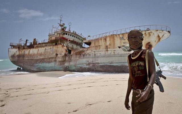 Somali pirate Abdi Ali stands near a Taiwanese fishing vessel. Credit: Reuters/Files