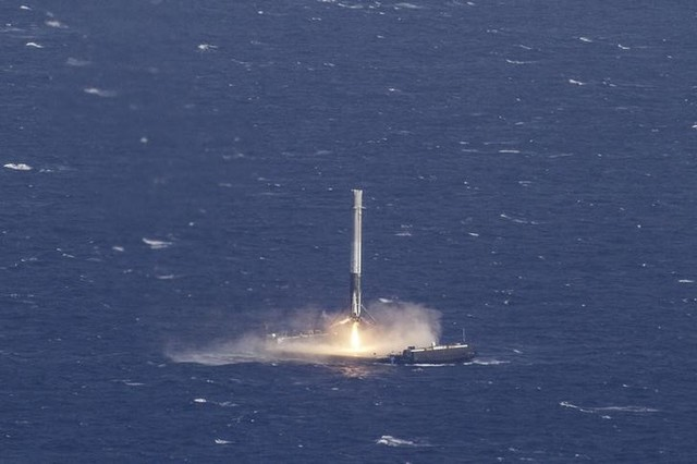 The reusable main-stage booster from the SpaceX Falcon 9 rocket makes a successful landing on a platform in the Atlantic ocean about 185 miles (300 km) off the coast of Florida April 8, 2016 in this handout photo provided by SpaceX. Credit: Reuters