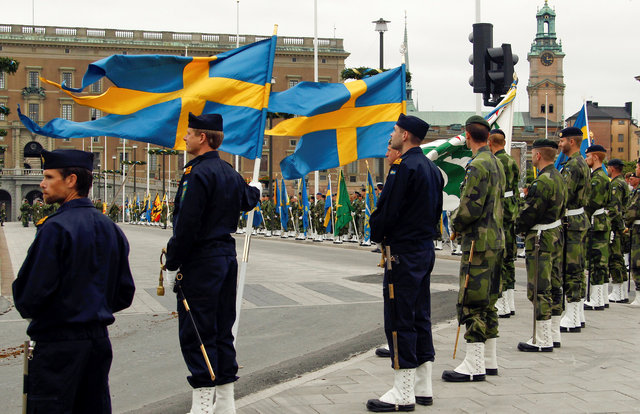 Swedish armed forces soldiers attend a rehearsal in front of the Royal Palace in Stockholm, Sweden June 18, 2010. Credit: Reuters