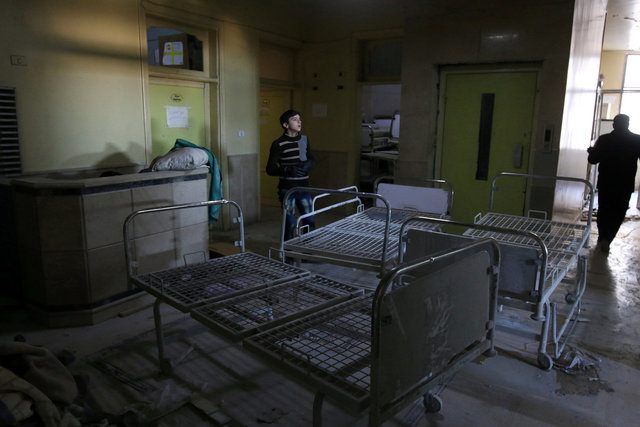 People inspect damage in Omar Bin Abdulaziz hospital, in the rebel-held besieged area of Aleppo, Syria November 19, 2016. Credit: Reuters/Abdalrhman Ismail/File Photo