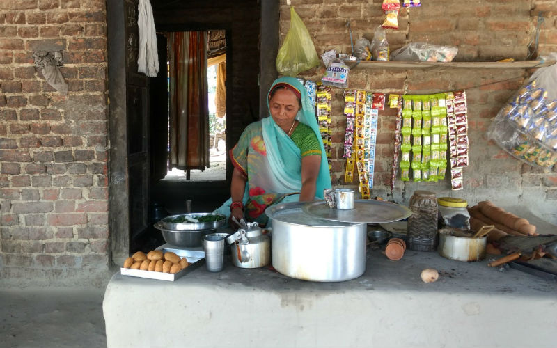 A woman at a tea stall in Phephna. Credit: Titash Sen