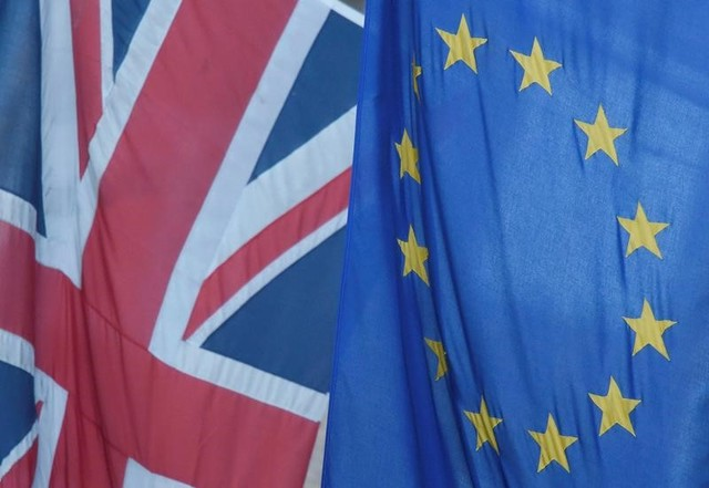 A Union flag flies next to the flag of the EU in Westminster, London, Britain June 24, 2016. Credit: Reuters