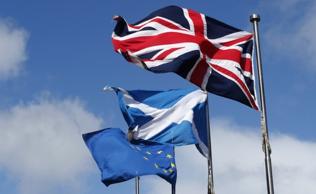 The Union flag,The Scottish Saltire and The European flag fly at the Scottish Parliament in Edinburgh Scotland, Britain March 21, 2017. Credit: Reuters