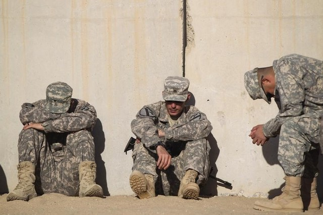 Soldiers from the 3rd brigade combat team, 1st Cavalry Division rest while waiting to pack their weapons for shipment back to the US at Camp Virginia, Kuwait December 19, 2011. Credit: Reuters