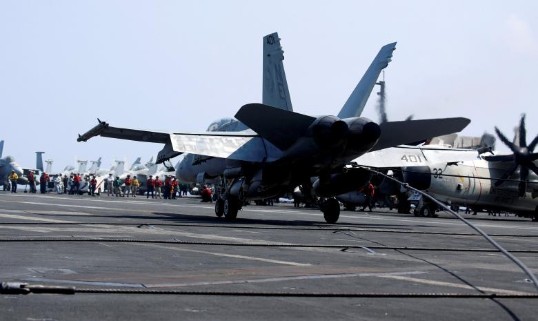 A U.S. Navy F18 fighter jet lands with the aid of a tail hook on the deck of aircraft carrier USS Carl Vinson during a routine exercise in South China Sea, March 3, 2017. Credit: Reuters/Erik De Castro