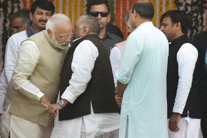 Mulayam Singh Yadav and Akhilesh Yadav with Narendra Modi. Credit: PTI/Files